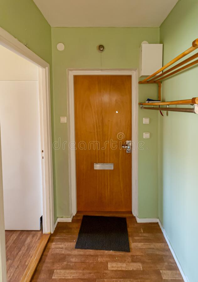 Door and hall of an apartment. Light green walls.  stock photo