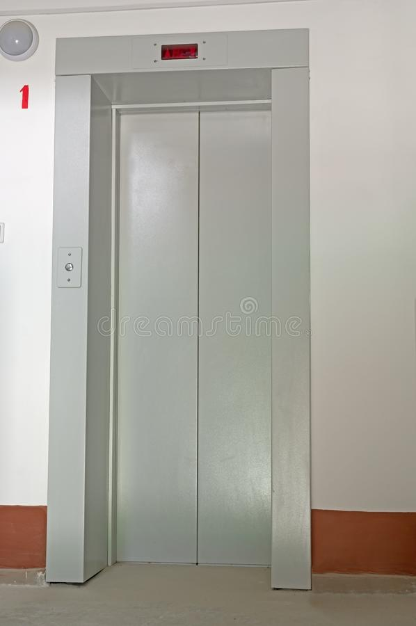 Elevator door in entrance hall of an apartment building. Elevator door in the entrance hall of an apartment building royalty free stock photography
