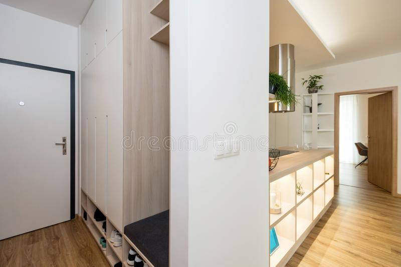 Entrance hall of contemporary apartment. With furniture stock images