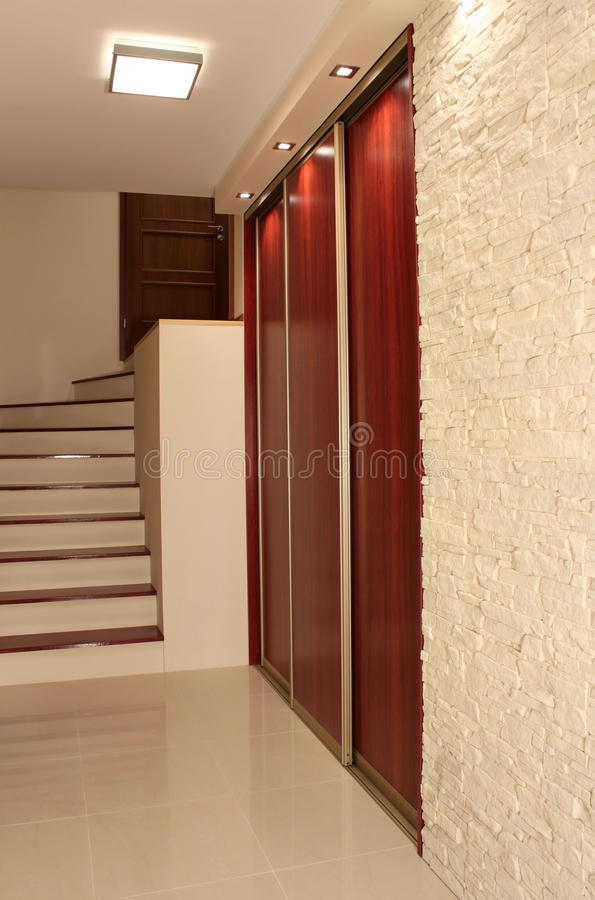 Hall with stairs in modern apartment. Modern hall with stairs in luxury apartment stock photos