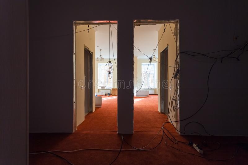 Interior of hall of apartment with temporary electric wires during upgrade or remodeling, renovation, extension. Restoration, reconstruction and construction stock photo