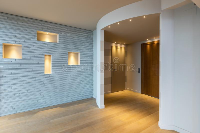 Modern apartment entrance with gray stripes on the wall. Nobody inside royalty free stock photos