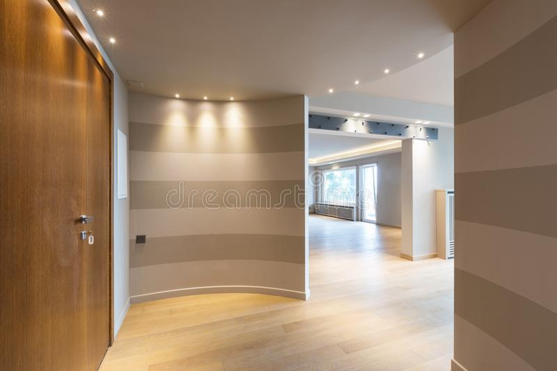 Modern apartment entrance with gray stripes on the wall. Nobody inside stock images