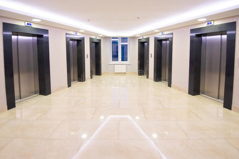 Modern clean elevator hall of apartment buidling. Marble floor, no people stock image