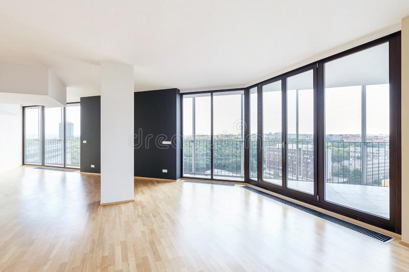 Modern white empty loft apartment interior with parquet floor and panoramic windows, Overlooking the metropolis city.  stock photos