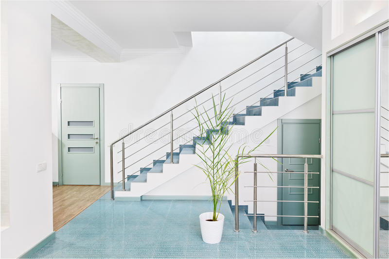 Part of modern hall interior with metal staircase. In minimalism style royalty free stock photography