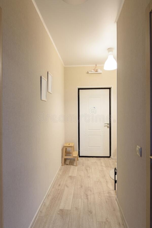 Passage from room to entrance hall in a one-room small apartment. Passage from room to entrance hall in a one-room small  apartment royalty free stock photo