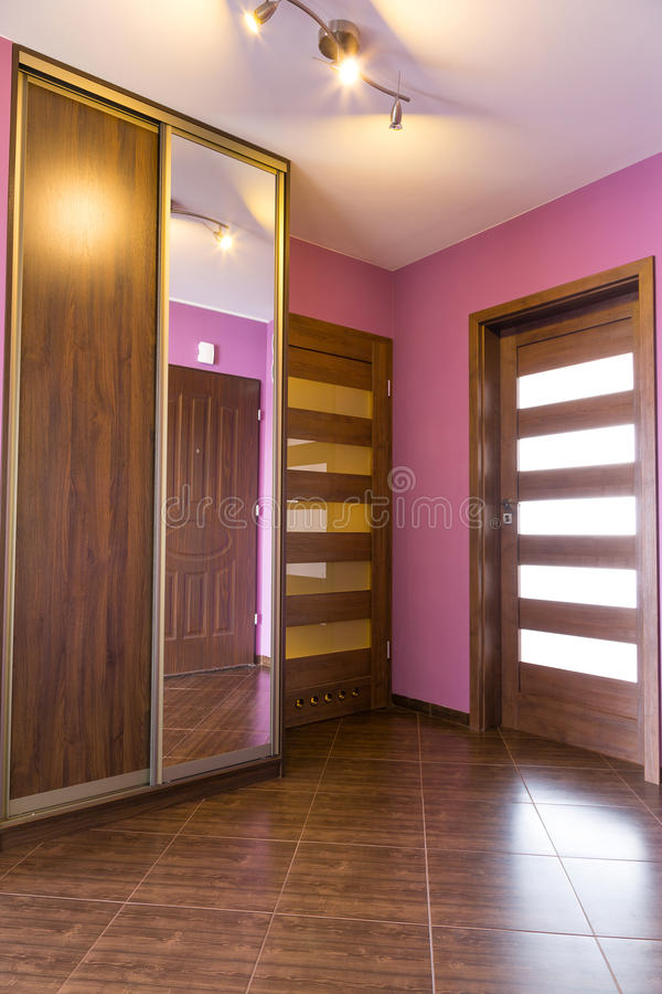 Purple hall interior in the apartment. Purple hall interior with brown tiles in the apartment stock images