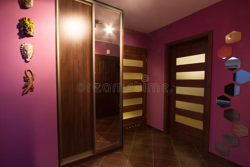 Purple hall with wardrobe. Interior stock photography