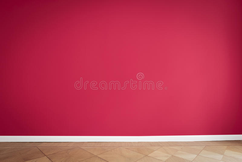 Red wall background, empty apartment room.  stock photography