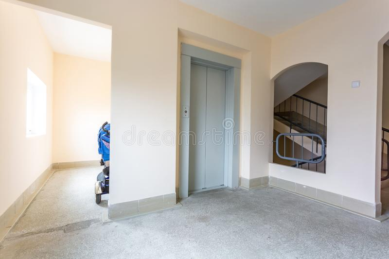 Staircase hall in an apartment building  at the entrance to the elevator. / stock photos