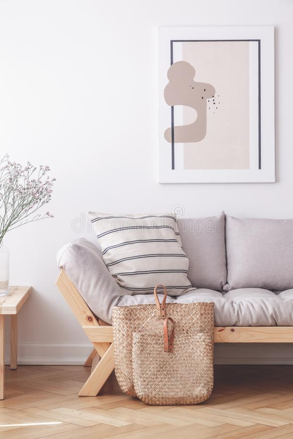 Two bags on the floor of stylish apartment with grey couch and framed print on the wall. Concept royalty free stock photos
