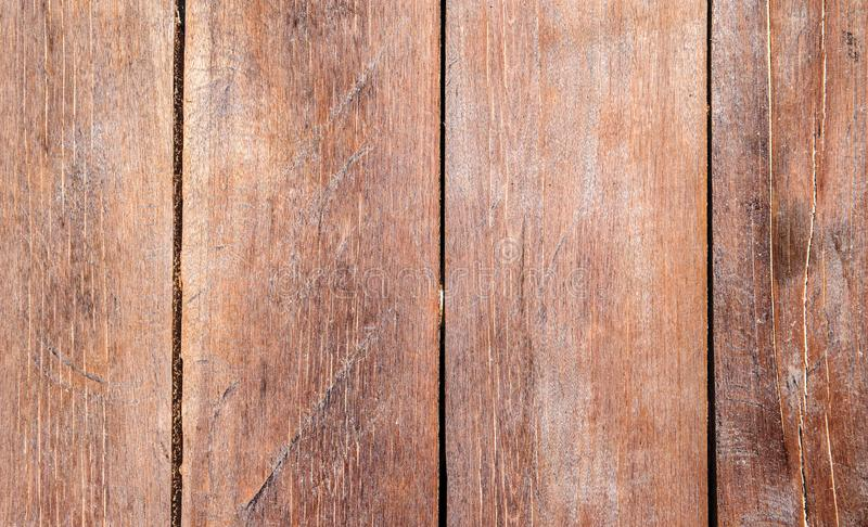 Warm brown wooden texture. Timber board top view photo background. Rustic wood backdrop. Natural wood texture.Polished wooden floor or wall. Natural building stock photo
