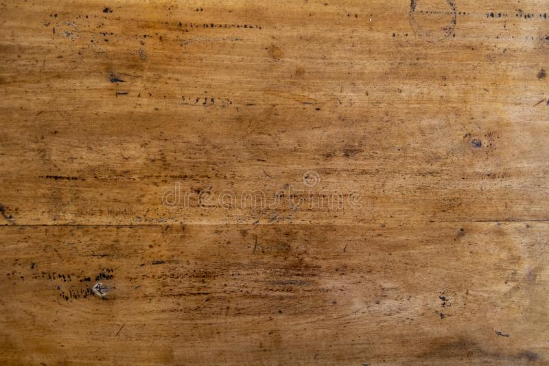 Warm wooden texture photo. Timber board with weathered crack flat lay. Rustic wooden table top view. Polished wood backdrop. Grungy lumber board. Distressed royalty free stock images
