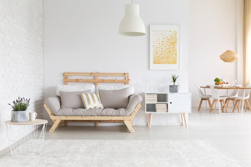 White brick wall in apartment. White brick wall and wooden furniture in apartment stock photos