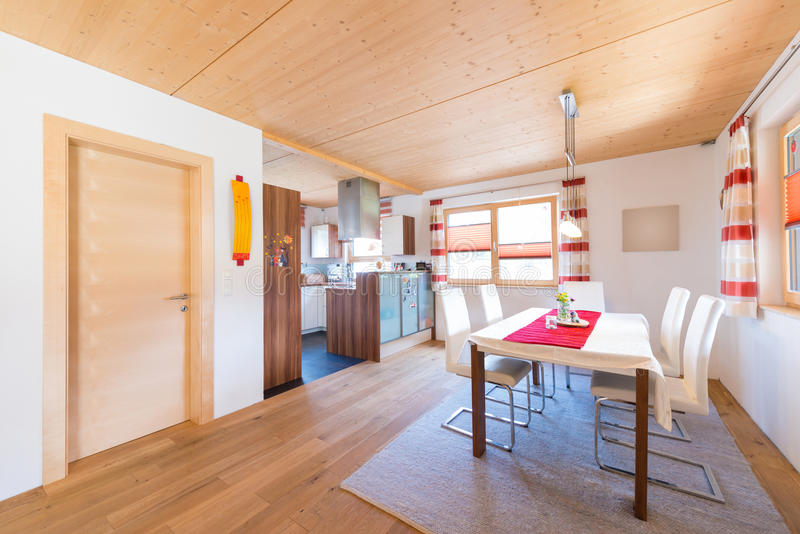 Wooden warm mud of kitchen and dining room. In timber house stock photos